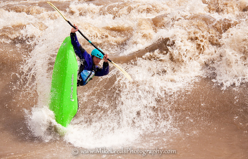"Paddler Will Parham with a big ""Clean Blunt"" at the Bladder Wave on the Main Payette River, Idaho."