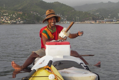 """This is Ross, the """"other"""" kayak fisherman in Grenada. I bumped into him about a mile off from the cruise ship dock back in early 2008. I've fished w/ him a bunch since then. He has a piece of plywood cut out for a paddle, never a PFD, he has since lost his hatch covers & uses homemade ones, he uses no rods, depth finders, fancy fluorocarbon leaders, or lures. And he catches huge fish, including tuna.  He fishes for fun, what he catches he shares w/ his neighbors. When he needs money he works. Really nice guy."""
