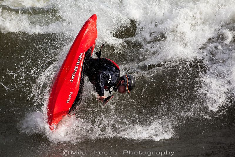 Dan Simenc with a big Air Blunt at the Bladder Wave on the Main Payette River, Idaho.