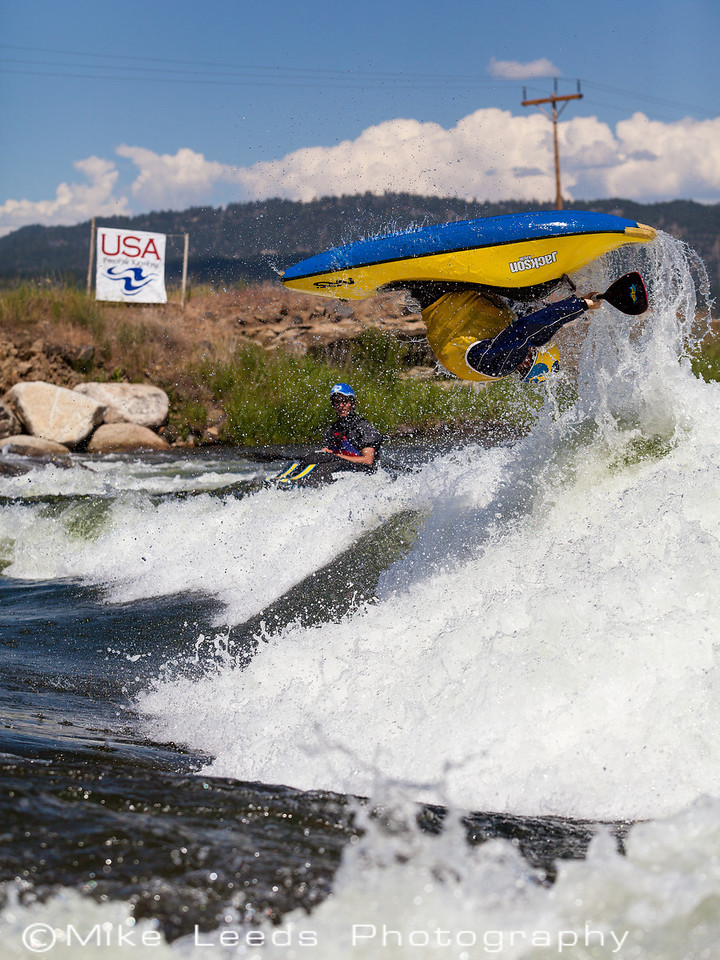 """Stephen Wright with a huge """"Air-Loop"""" at Kelly's Whitewater Park during warmups for USA Freestyle Nationals, N.F. Payette River, Cascade Idaho"""