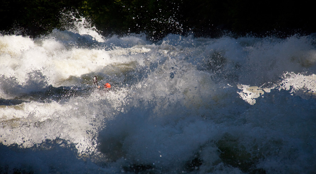 "Paddler Brian Ward rounding the corner in ""Screaming Left Turn"" on the North Fork Payette River in Idaho. 7,000cfs+"
