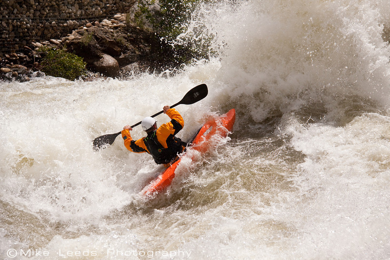 """Paddler James Byrd about to throw a huge """"Kick-Flip"""" in Juicer Rapid on the North Fork Payette River.  8,000cfs+"""