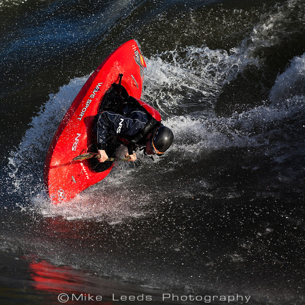 Dan Simenc throwing an Air Blunt at the Bladder Wave, Main Payette River in Idaho.