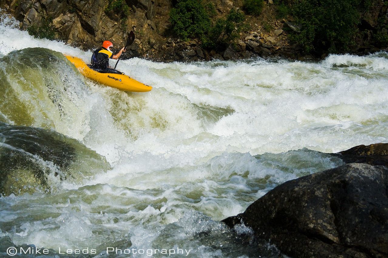 """Brian Ward going big in """"Hounds Tooth"""" at high water on the North Fork Payette River in Idaho."""