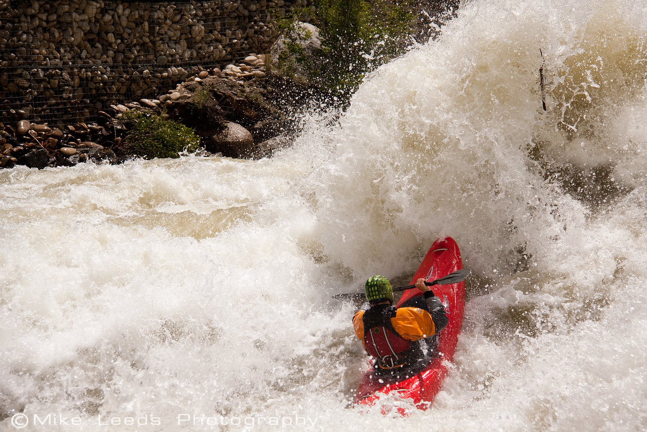 """Sam Wells in """"Juicer"""" rapid on the North Fork Payette River in Idaho. 8,000cfs+ --- 2010"""