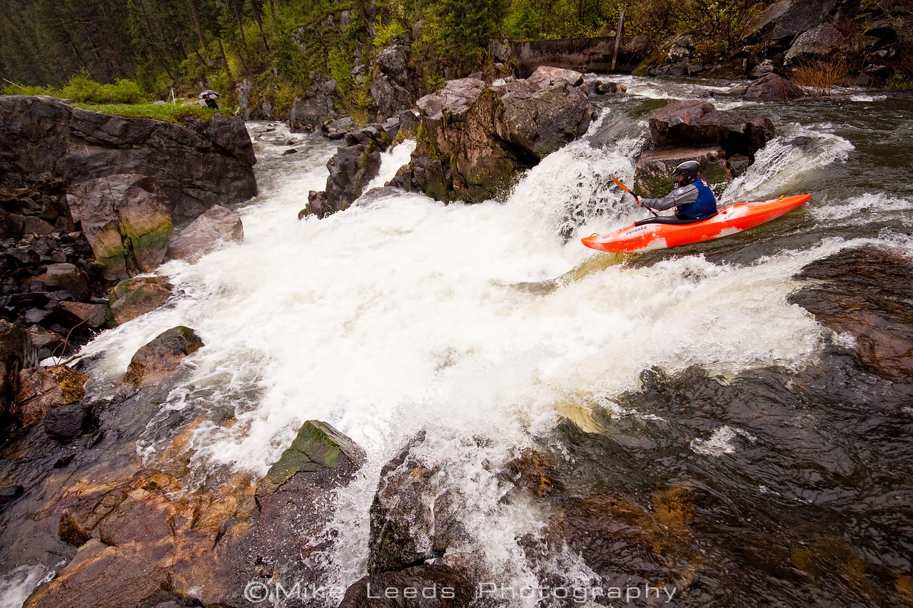 "Paddler Tyler Allyn at the top of ""The Intimidator"" on the Little Salmon River, Idaho."