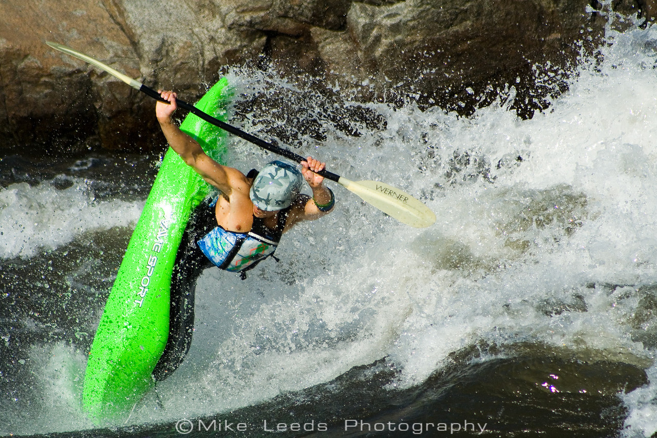 Paddler Will Parham going big and stylish with a huge Clean Blunt at Climax Surf Wave. Main Payette River in Idaho.