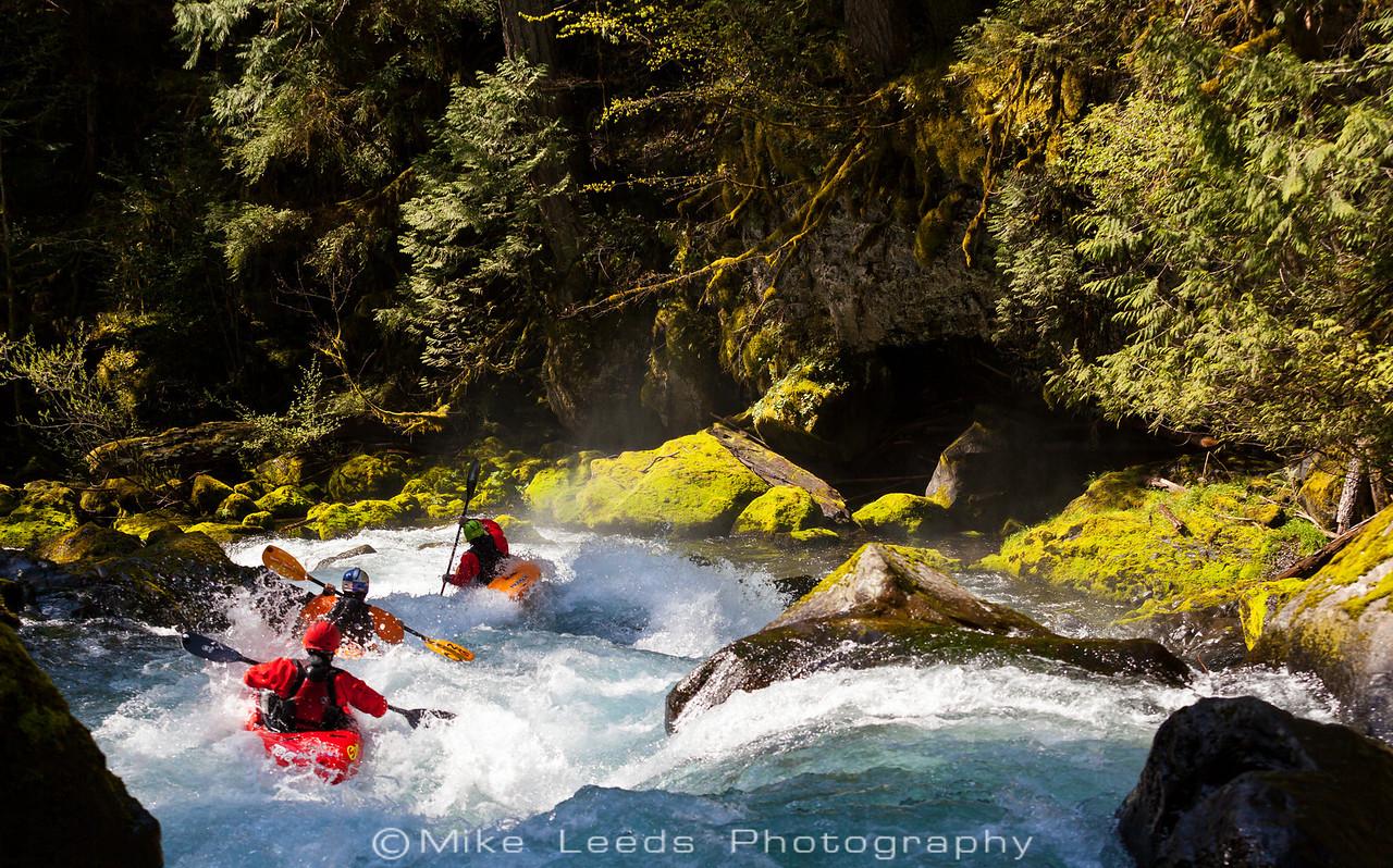 Rush Sturges, Rafa Ortiz, and Evan Garcia in Boulder Sluice on the Little White Salmon River in Washington.
