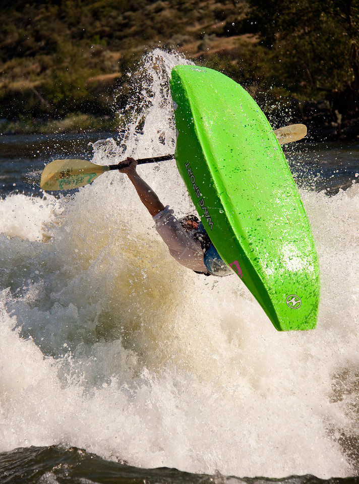 """Will Parham with a giant """"Loop"""" at Climax surf wave on the Main Payette River, Idaho."""