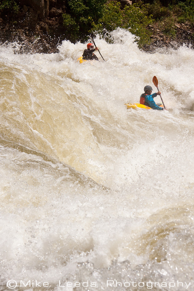"Paddlers James McLeod and Brian Ward in ""Hounds Tooth"" on the North Fork Payette River, Idaho. 7,000-8,000cfs."