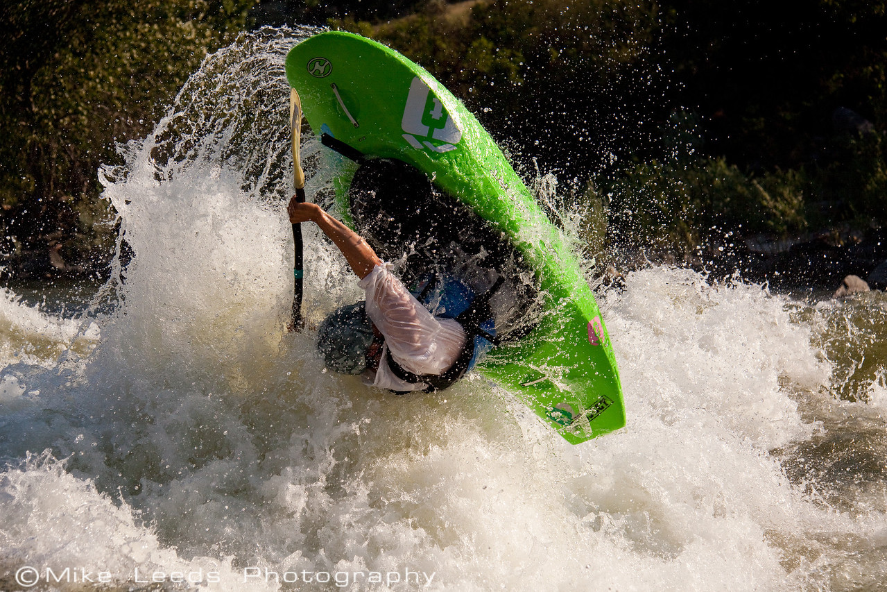 "Will Parham with a big ""Space Godzilla"" at Climax surf wave on the Main Payette RIver, Idaho."