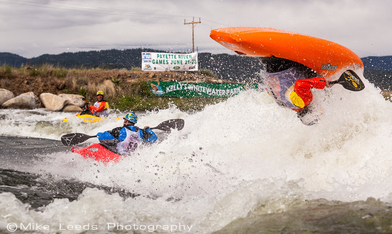 Dane Jackson with a big Air Loop just after the freestyle finals at Kellys Whitewater Park during the Payette River Games 2013