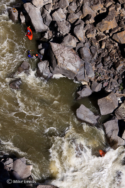 Brian Ward pulling Tyler Allyn the rest of the way to shore after his implosion bar broke on his skirt, forcing him to swim after successfully running the Devil's Washbowl on the Malad River, Idaho.