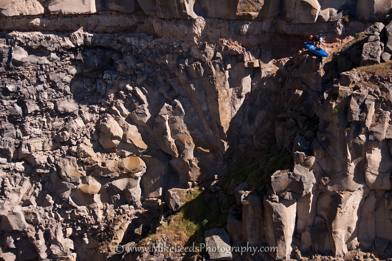 Brian Ward on his descent to the bottom of Devil's Washbowl to set saftey for Tyler Allyn and Dan Simenc. Malad River Canyon Idaho.