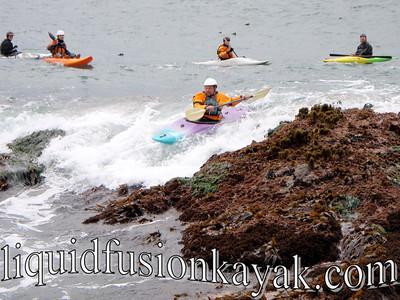 Kayaking Mendocino Coast Rock Gardens in a whitewater kayak.