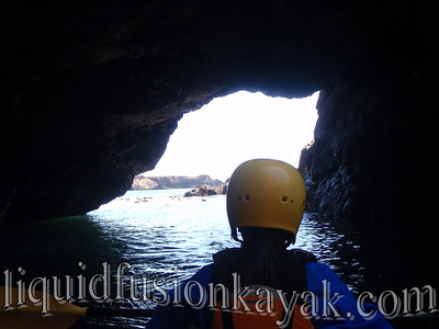 Sea kayaking in sea caves near Fort Bragg.