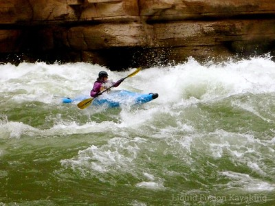 Cate in Upset Rapid in the Grand Canyon.  Photo by Tricia Melosh