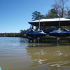 Snow bound jet skis and snow covered roof