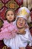 Grandmother granddaughter affection, inside a traditional yurt, Almaty, Kazakhstan