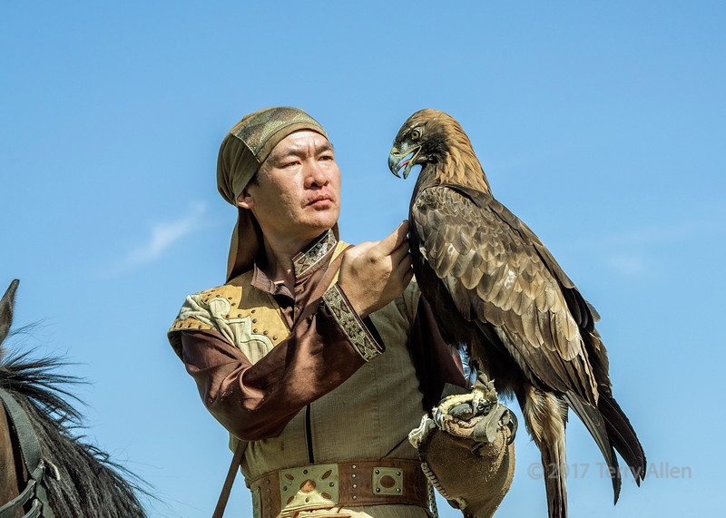 Kazakh eagle trainer bonds with his eagle, Sunkar Falcon Center, Almaty, Kazakhstan