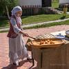 Kazakh woman showing how to make Baursak (puffy bread), Almaty, Kazakhstan
