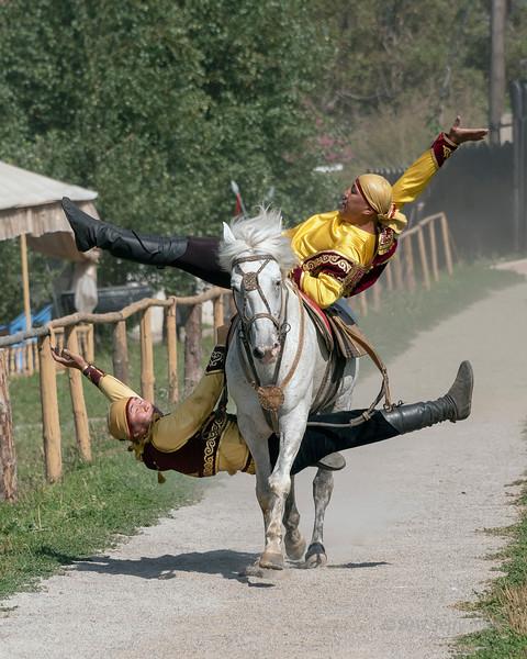 Two Kazakh trick riders on a white horse, Alamty, Kazakhstan<br /> <br /> add keyword