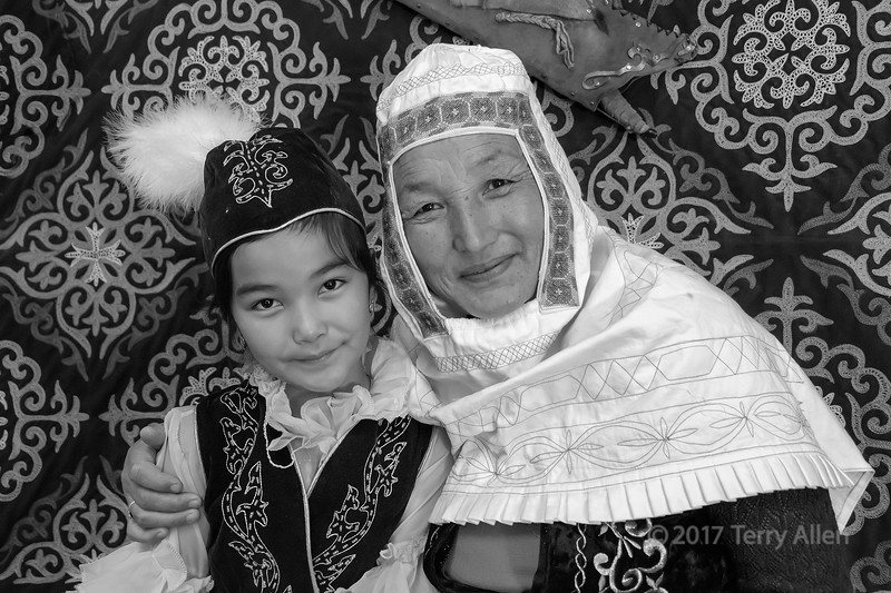 Affectioinate granddaughter and grandmother inside a traditional yurt, Almaty, Kazakhstan