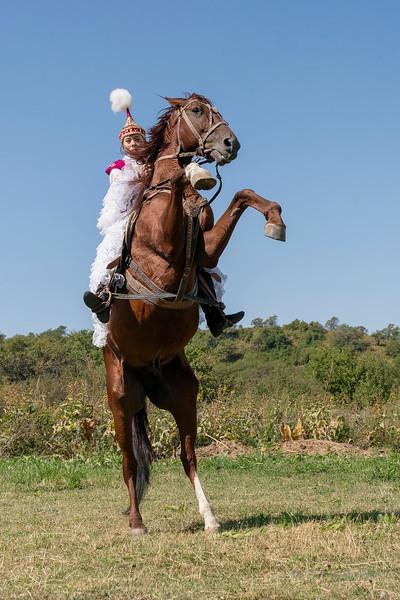 Kazakh woman in traditional attire demonstrating her horse skills, Almaty, Kazakhstan