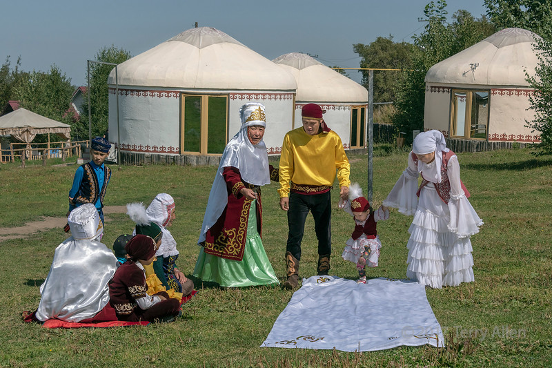 'Tusau Kesu' ceremony (cutting the rope) the first step with family in festive attire, Almaty, Kazakhstan