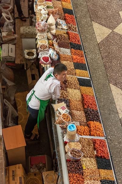 Man selling dried fruit and nuts, Green (Zelyony) Bazaar, Almaty, Kazakhstan
