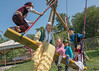 Fun on a swing, young Kazakhs in festive attire, Almaty, Kazakhstan