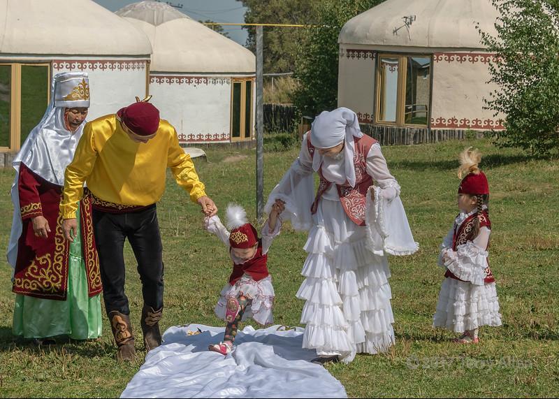 'Tusau Kesu' ceremony (cutting the rope) child swinging in the air, Almaty, Kazakhstan