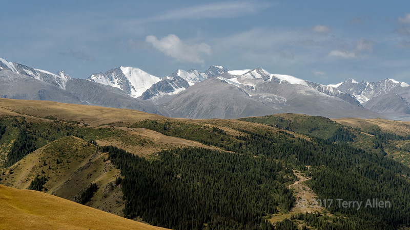 High in the Assy Plateau looking towards the snow-covered Zailysky Alatau Range of the Tian Shan mountains