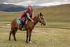 Herder stroking her horse