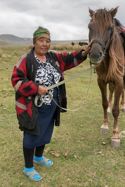 Kazakh woman with a favorite horse, Assy Plateau, Kazakhstan