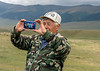 Modern times, a herder on the Assy Plateau uses his smart phone to take a photo, Kazakhstan