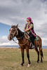 Kazakh woman on horseback watching for a storm, Assy Plateau, Kazakhstan