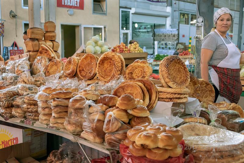 Kazakh baked goods and baker, Shymkent market, Shymkent, Kazakhstan
