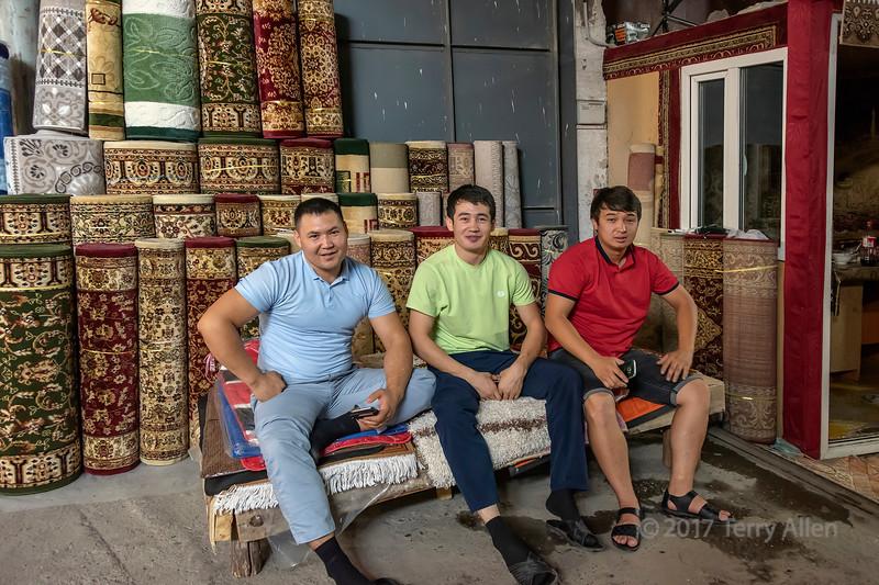 Smiling carpet salesmen at the Shymkent market, Kazakhstan