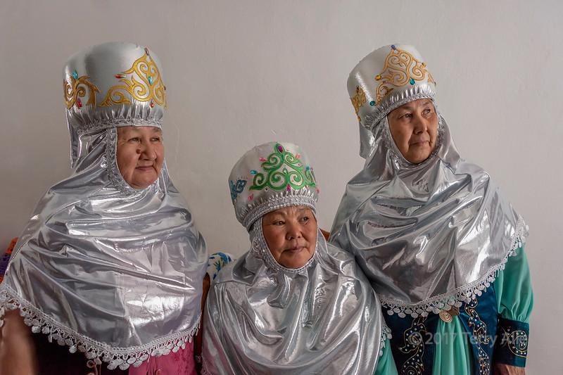 Trio of Kazakh village elders in traditional attire, Sharafkent, Kazakhstan