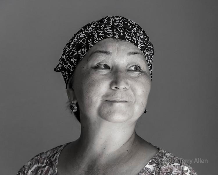 Portrait of a Kazakh woman in natural light from a window BW, Sharafkent, Kazakhstan