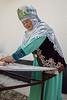 Kazakh elder rolling out yeasted dough for baursak, Sharahkent, Kazakhstan