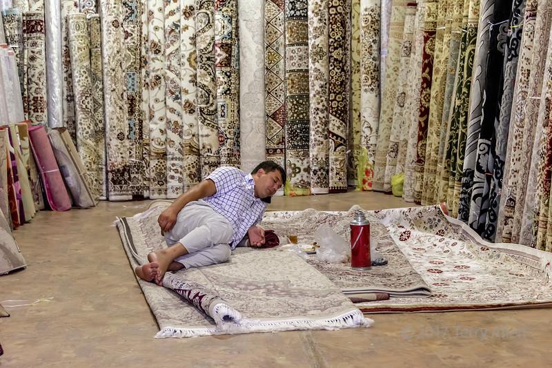 Siesta tilme in the carpet shop, Shymkent Market, Shymkent, Kazakhstan