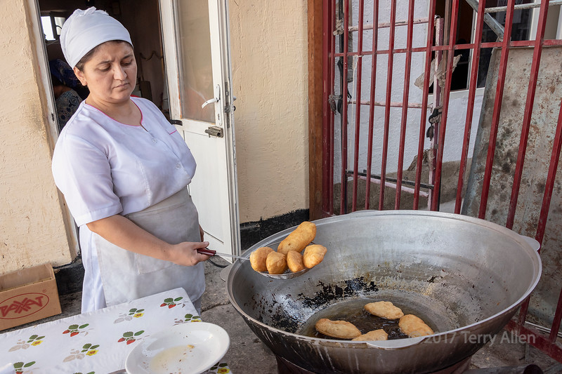 Woman making baursak (Kazakh fried dough) at the Shymkent market, Kazakhstan