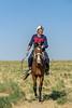 Portrait of a Kazakh camel wrangler, near Turkestan, Kazakhstan
