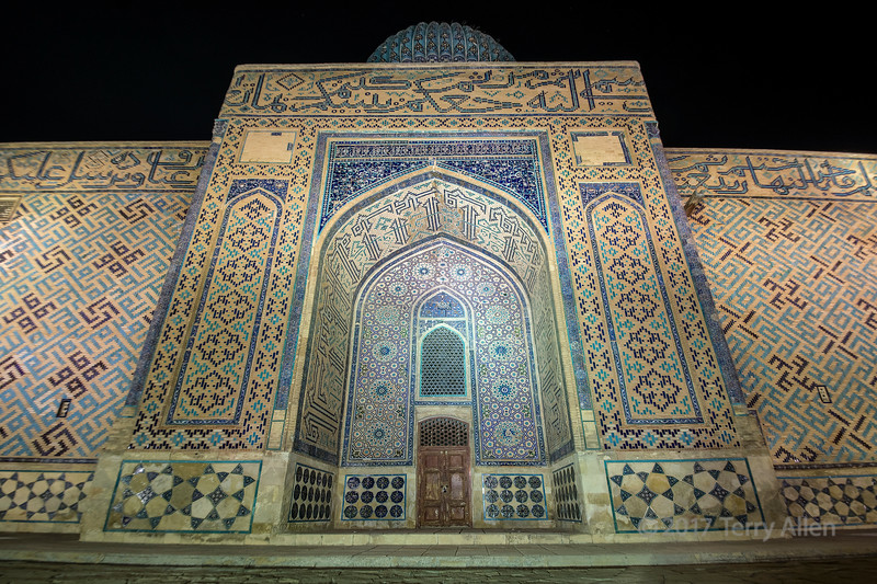 A night shot of the Timurid era mausoleum of Khoja Ahmed Yasawi, the famous Turkic poet and Sufi mystic (1093–1166) taken when it was lit up with artificial lights after dark.  The amazing mosaics glowed against the dark background. The structure was commissioned in 1389 by Timur, who ruled the area as part of the expansive Timurid Empire to replace a smaller 12th-century mausoleum.