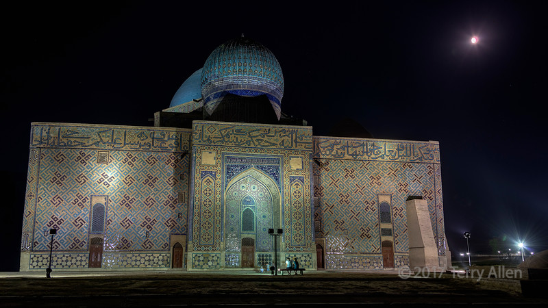 Mausoleum of Khoja Ahmed Yasawi with night lights and gibbous moon, Turkestan, Kazakhstan