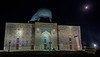 Mausoleum of Khoja Ahmed Yasawi with night lights and gibbous moon, Turkestan, Kazakhstan