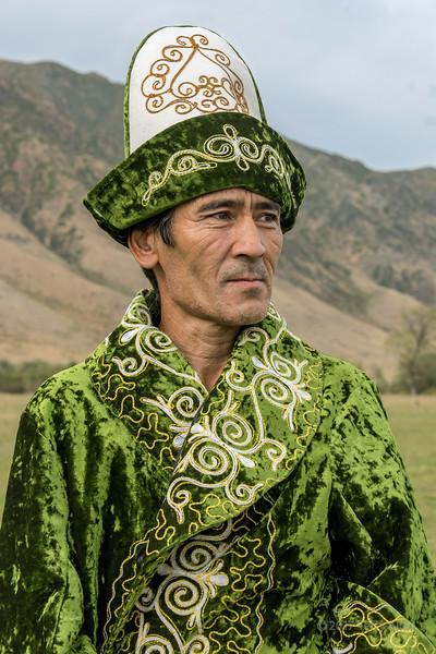 Kazakh man in green,  near Kolsay Lake, Kazakhstan