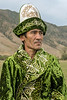 Kazakh man in green,  near Kolsay Lake, Kazakhstan
